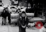 Image of Japanese workers and training of children for war Japan, 1941, second 36 stock footage video 65675040809