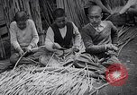 Image of Japanese workers and training of children for war Japan, 1941, second 39 stock footage video 65675040809
