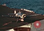 Image of Navy fighter aircraft landing on USS Essex Pacific Theater, 1945, second 35 stock footage video 65675040813