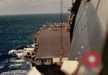 Image of Navy fighter aircraft landing on USS Essex Pacific Theater, 1945, second 37 stock footage video 65675040813