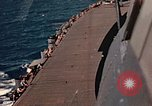 Image of Navy fighter aircraft landing on USS Essex Pacific Theater, 1945, second 45 stock footage video 65675040813
