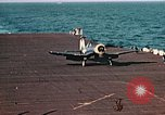 Image of Navy fighter aircraft landing on USS Essex Pacific Theater, 1945, second 51 stock footage video 65675040813