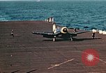 Image of Navy fighter aircraft landing on USS Essex Pacific Theater, 1945, second 52 stock footage video 65675040813