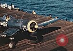 Image of Navy fighter aircraft landing on USS Essex Pacific Theater, 1945, second 56 stock footage video 65675040813