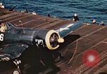Image of Navy fighter aircraft landing on USS Essex Pacific Theater, 1945, second 57 stock footage video 65675040813