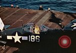 Image of Navy fighter aircraft landing on USS Essex Pacific Theater, 1945, second 59 stock footage video 65675040813