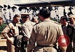 Image of US Army fliers look at various airplanes on airfield Kumming China, 1942, second 4 stock footage video 65675040867