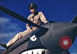Image of US Army fliers look at various airplanes on airfield Kumming China, 1942, second 10 stock footage video 65675040867