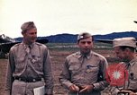 Image of US Army fliers look at various airplanes on airfield Kumming China, 1942, second 14 stock footage video 65675040867