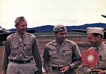 Image of US Army fliers look at various airplanes on airfield Kumming China, 1942, second 15 stock footage video 65675040867