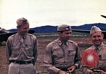Image of US Army fliers look at various airplanes on airfield Kumming China, 1942, second 16 stock footage video 65675040867
