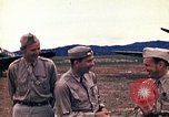 Image of US Army fliers look at various airplanes on airfield Kumming China, 1942, second 17 stock footage video 65675040867