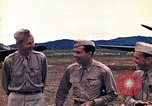 Image of US Army fliers look at various airplanes on airfield Kumming China, 1942, second 18 stock footage video 65675040867
