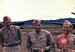 Image of US Army fliers look at various airplanes on airfield Kumming China, 1942, second 19 stock footage video 65675040867