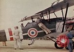 Image of US Army fliers look at various airplanes on airfield Kumming China, 1942, second 21 stock footage video 65675040867