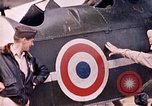 Image of US Army fliers look at various airplanes on airfield Kumming China, 1942, second 27 stock footage video 65675040867