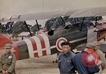 Image of US Army fliers look at various airplanes on airfield Kumming China, 1942, second 33 stock footage video 65675040867