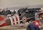 Image of US Army fliers look at various airplanes on airfield Kumming China, 1942, second 34 stock footage video 65675040867