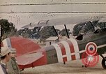 Image of US Army fliers look at various airplanes on airfield Kumming China, 1942, second 39 stock footage video 65675040867