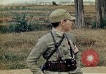 Image of US Army fliers look at various airplanes on airfield Kumming China, 1942, second 48 stock footage video 65675040867