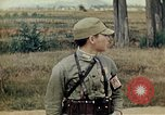 Image of US Army fliers look at various airplanes on airfield Kumming China, 1942, second 52 stock footage video 65675040867