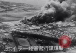 Image of Japanese attacking Ford Island Pearl Harbor Hawaii USA, 1941, second 40 stock footage video 65675041079