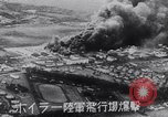 Image of Japanese attacking Ford Island Pearl Harbor Hawaii USA, 1941, second 42 stock footage video 65675041079
