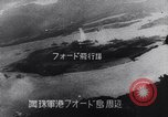 Image of Japanese attacking Ford Island Pearl Harbor Hawaii USA, 1941, second 48 stock footage video 65675041079