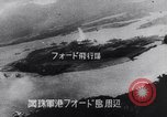 Image of Japanese attacking Ford Island Pearl Harbor Hawaii USA, 1941, second 49 stock footage video 65675041079