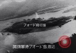 Image of Japanese attacking Ford Island Pearl Harbor Hawaii USA, 1941, second 51 stock footage video 65675041079