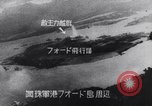Image of Japanese attacking Ford Island Pearl Harbor Hawaii USA, 1941, second 53 stock footage video 65675041079