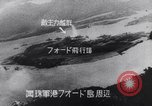 Image of Japanese attacking Ford Island Pearl Harbor Hawaii USA, 1941, second 54 stock footage video 65675041079