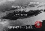 Image of Japanese attacking Ford Island Pearl Harbor Hawaii USA, 1941, second 58 stock footage video 65675041079