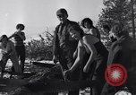 Image of tree cutting contest Luther Washington USA, 1935, second 42 stock footage video 65675041274