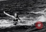 Image of surfing Venice Beach Los Angeles California USA, 1935, second 30 stock footage video 65675041280