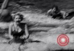 Image of surfing Venice Beach Los Angeles California USA, 1935, second 33 stock footage video 65675041280