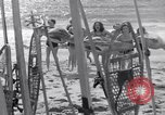 Image of surfing Venice Beach Los Angeles California USA, 1935, second 38 stock footage video 65675041280
