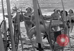 Image of surfing Venice Beach Los Angeles California USA, 1935, second 39 stock footage video 65675041280