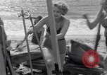 Image of surfing Venice Beach Los Angeles California USA, 1935, second 42 stock footage video 65675041280