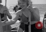 Image of surfing Venice Beach Los Angeles California USA, 1935, second 44 stock footage video 65675041280