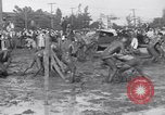 Image of mud wrestling Los Angeles California USA, 1936, second 14 stock footage video 65675041292