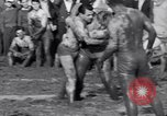 Image of mud wrestling Los Angeles California USA, 1936, second 16 stock footage video 65675041292