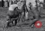 Image of mud wrestling Los Angeles California USA, 1936, second 27 stock footage video 65675041292