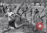 Image of mud wrestling Los Angeles California USA, 1936, second 58 stock footage video 65675041292