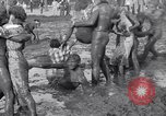 Image of mud wrestling Los Angeles California USA, 1936, second 60 stock footage video 65675041292