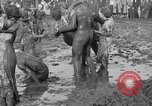 Image of mud wrestling Los Angeles California USA, 1936, second 62 stock footage video 65675041292