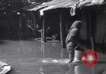 Image of Heavy rains West Bengal India, 1967, second 20 stock footage video 65675041329