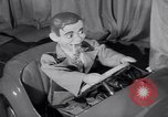 Image of Charlie McCarthy driving a car Princeton New Jersey USA, 1953, second 10 stock footage video 65675041357