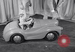 Image of Charlie McCarthy driving a car Princeton New Jersey USA, 1953, second 12 stock footage video 65675041357