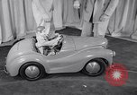 Image of Charlie McCarthy driving a car Princeton New Jersey USA, 1953, second 13 stock footage video 65675041357